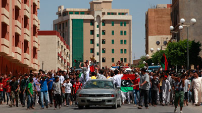 Fighting rages near Gaddafi compound