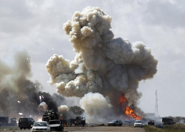 Libyan 'rebels' sorround cities loyal to Gaddafi