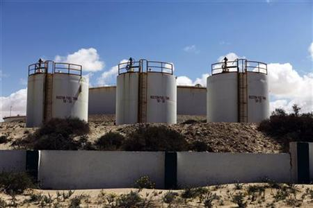 Storage tanks stand at the oil refinery at Zueitina near the northeastern Libyan town of Ajdabiyah