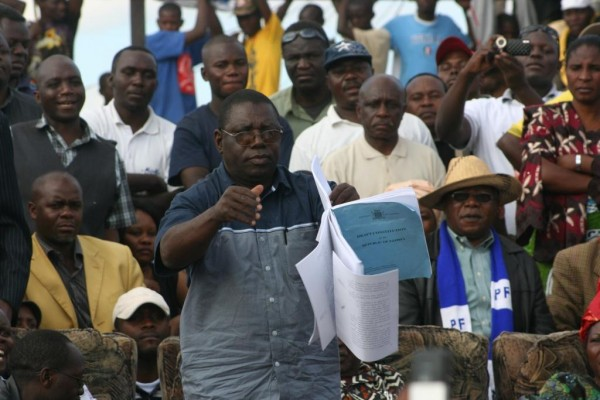 Photo of the day: PF official tearing Draft constitution while Sata claps