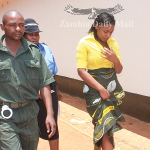The Lusaka Magistrate Court has convicted former Community Development Minister Michael Kaingu's daughter Iris for making obscene,Here Iris been taken to Lusaka Central Prison yesterday.-Picture by COLLINS PHIRI
