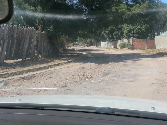 Minister Simusa's company fails to complete road works in Chingola