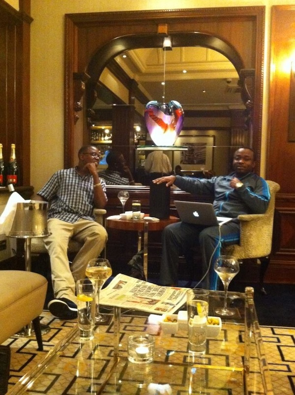 Photo of the day: Chellah tastes wine as he waits for Sata in hospital