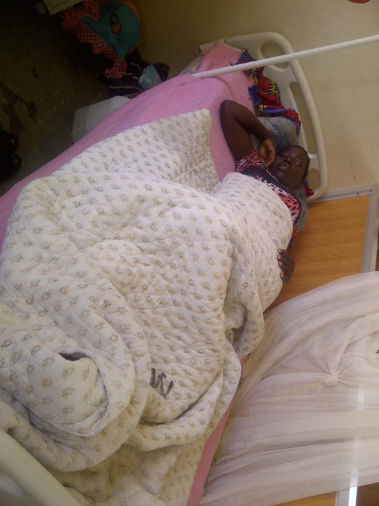 Mrs. in'utu wanguma lying in her hospital bed at Lewanika where she is recovering