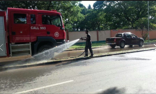 Photos of the day: Fire-brigade turned into state house lawn attendants