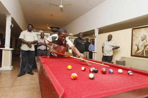 Photo of the day: President playing pool, retired teacher suffering