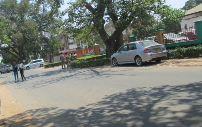 police guarding the Central province admin office