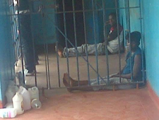 Photo of the day: male and female detainees sharing police cell