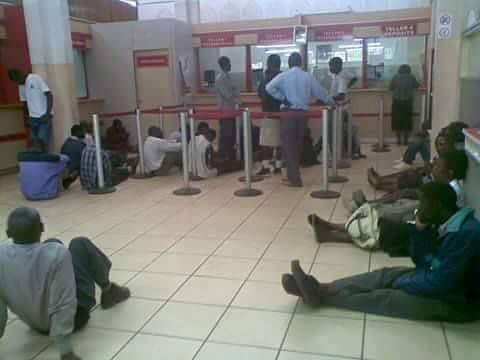 Photo of the day: teachers sit in bank to wait for salaries
