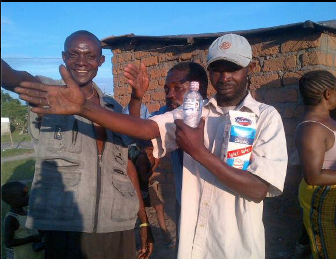 Photo of the day: Kandabwe dwellers receive beer, water from PF but salute HH