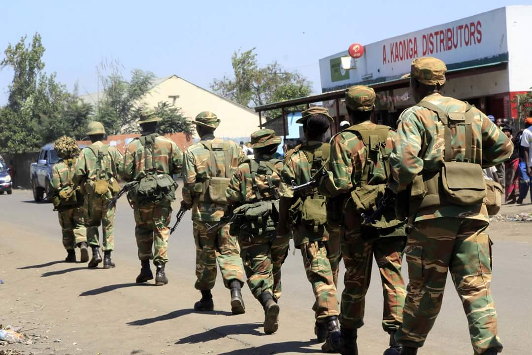 Soldiers move into compounds
