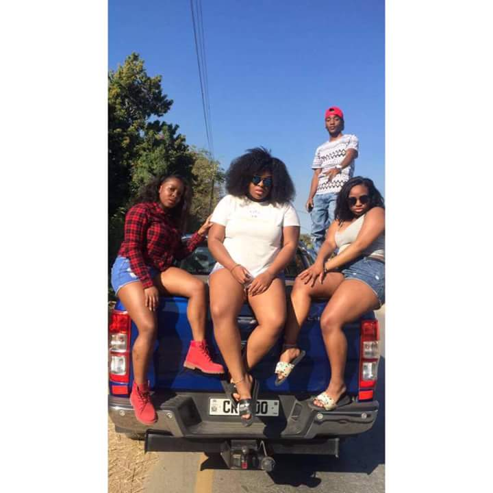 Chanda (right) with her fellows pose on one of Kambwili's CK personalised vehicles