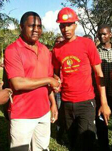 Remmy Mukoba shakes hands with his party leader