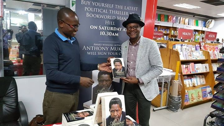 Mukwita selling Lungu's book to children