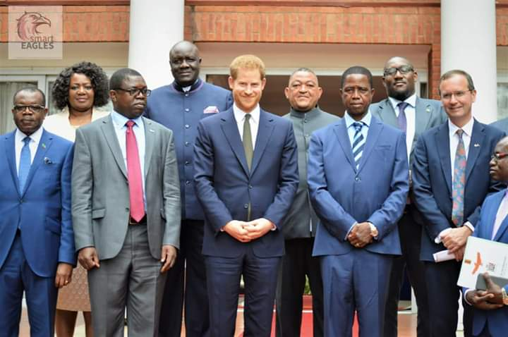 Prince Harry taking photos with drug traffickers in Zambia