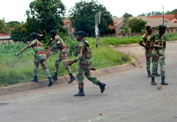 Security forces in Zimbabwe kill 12 protesters in broadest crackdown on unrest in years