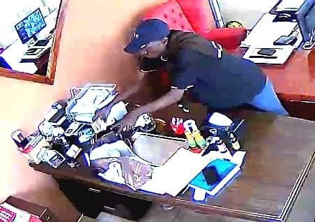 Man caught on camera stealing money